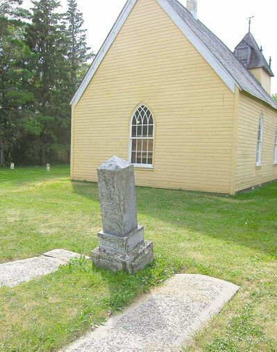 Graves dating back 150 years surround the historic log church near Poplar Point.