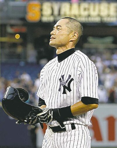 Ichiro Suzuki stands at first base after connecting for his 4,000th career hit Wednesday.