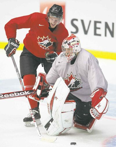 Team Canada goaltender Zachary Fucale and forward Anthony Mantha have fun in practice Friday, but the pressure will be on today.