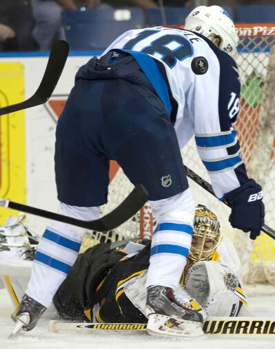 Bruins goalie Tuukka Rask stops a puck from Jets forward Bryan Little during first period NHL pre-season hockey action in Saskatoon on Friday.