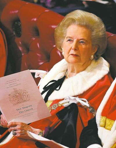 Margaret Thatcher is seen in a 2006 photo awaiting a speech by the Queen.