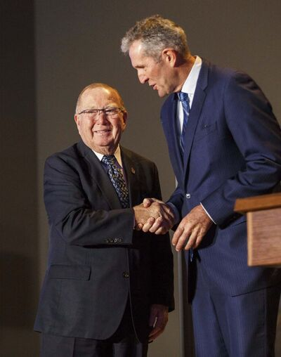 Ralph Eichler (MLA for Lakeside) is sworn in as the minister of the new department of economic development and training. He will add responsibility for post-secondary education to his job description. (Mike Deal / Winnipeg Free Press)</p>