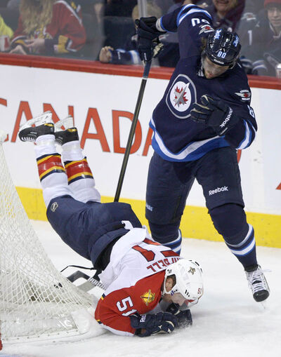 Winnipeg Jets' Nik Antropov upends Florida Panthers' Brian Campbell during the first period at the MTS Centre in Winnipeg Tuesday night.