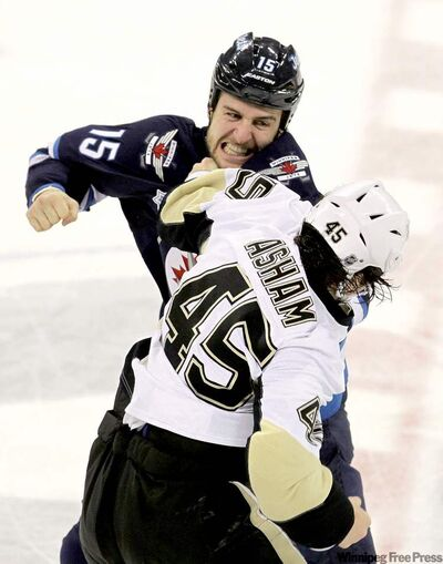 The Jets' Tanner Glass and Portage la Prairie product Arron Asham of the Penguins square off in fisticuffs Friday.