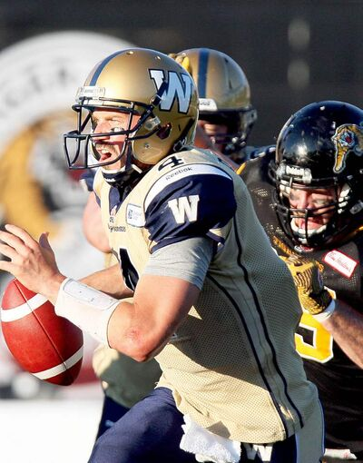 Winnipeg Blue Bombers quarterback Buck Pierce runs for his life against the Hamilton Tiger-Cats Saturday.