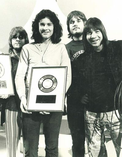 The Guess Who receiving their first gold record for selling one million copies of their 45 These Eyes.