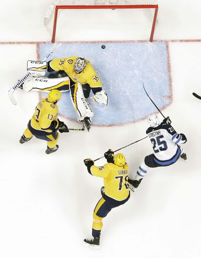 (AP Photo/Mark Humphrey)</p><p>Winnipeg Jets center Paul Stastny scores on Nashville Predators goalie Pekka Rinne during the second period Friday.</p>