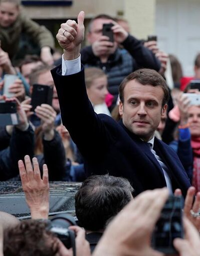 French independent centrist presidential candidate Emmanuel Macron gives a thumbs up as he leaves the polling station after casting his ballot in the presidential runoff election in Le Touquet, France, Sunday, May 7, 2017. Voters across France are choosing a new president in an unusually tense and important election that could decide Europe's future, making a stark choice between pro-business progressive candidate Emmanuel Macron and far-right populist Marine Le Pen. (AP Photo/Christophe Ena)