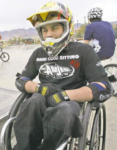 "Aaron Fotheringham, 15, Vegas AMJam Team Member, waits his turn to ride the ramps of Bunker Skatepark in North Las Vegas, Feb. 10, 2007. Fotheringham, nickname ""Wheels,"" maneuvers in his wheelchair, or as he termed it, Hard Core Sitting, around skate parks throughout the Vegas Valley, and recently in Germany. (AP Photo/Jane Kalinowsky)"