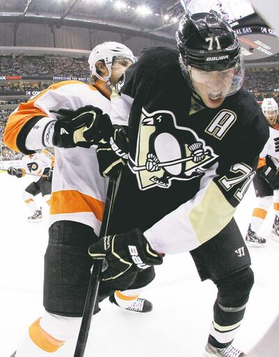 gene puskar / the associated press archivesThe Pittsburgh Penguins� Evgeni Malkin (71) is six days symptom-free and says �I�ll try� to get back in the scoring race.
