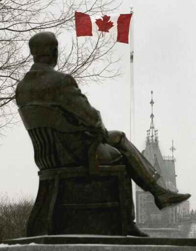 A statue of Lester B. Pearson appears to watch the Canadian flag flutter in the distance.