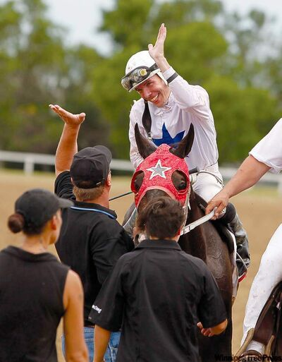 Jockey Mark Anderson celebrates after winning the Manitoba Lotteries Derby aboard Hammers Bullet Monday at Assiniboia Downs.