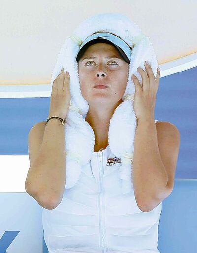 Maria Sharapova wraps an ice-towel around her head during a break in today's action.
