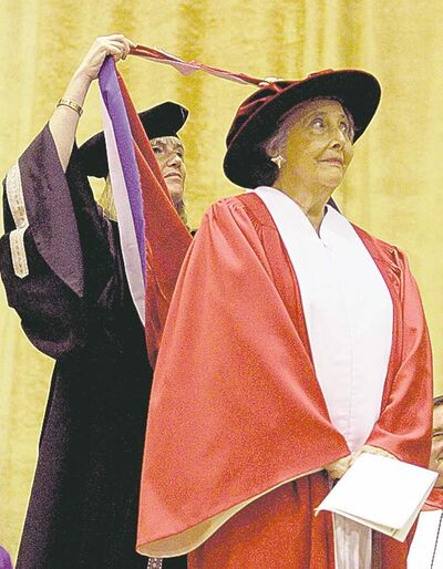 Page receives an honorary degree from the  University of WInnipeg.