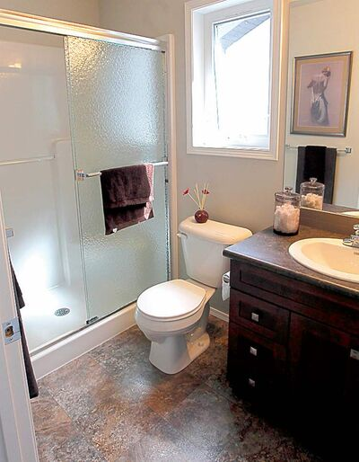 Highlights in the master bath include a large walk-out shower.