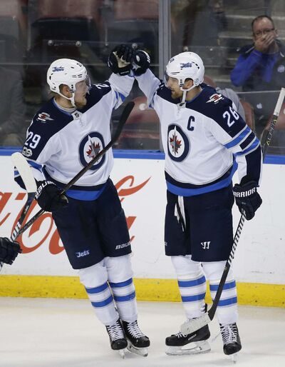 <p>Winnipeg Jets right wing Patrik Laine congratulates right wing Blake Wheeler after Wheeler scored during the second period.</p>