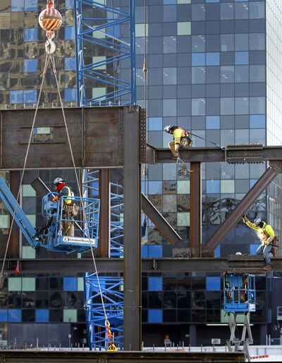 Workers at the site of the convention centre Tuesday.
