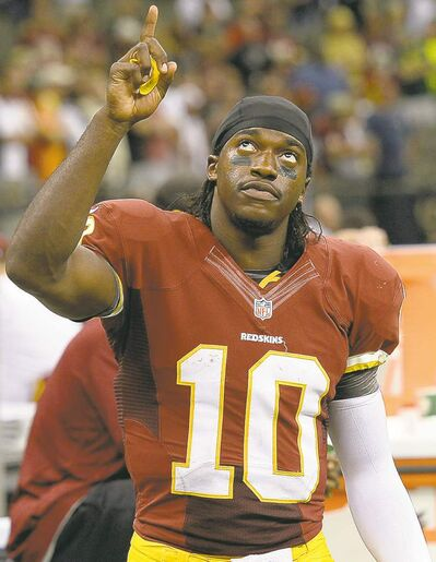 Robert Griffin III set a rookie QB rushing  record with 815 yards in 2012.