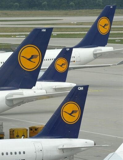 "FILE - This Aug. 1, 2008 file photo shows German airline Lufthansa planes stand on the airfield at the airport in Munich, southern Germany. Lufthansa AG says Thursday, March 15, 2012, it expects lower profits this year as high fuel prices and economic uncertainties weigh on earnings. The company said its operating profit is expected to slide from euro 820 million (US dollar1.1 billion) in 2011 to a ""mid three-figure million euro range"" in 2012. (AP Photo/Uwe Lein, File)"