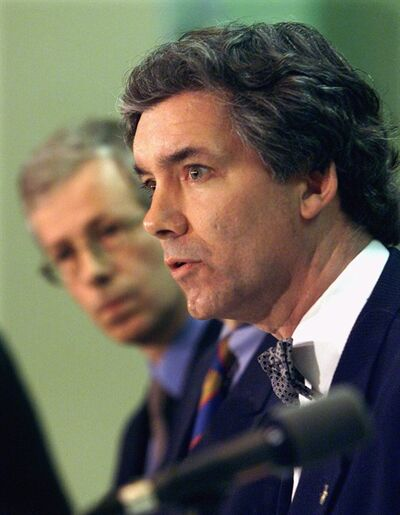 Daniel Turp makes a statement as Stephane Dion in Montreal in this March 23, 2000 file photo. A group led by Turp is taking the Canadian government to court in the hope of overturning Ottawa's decision to withdraw from the Kyoto Protocol. THE CANADIAN PRESS/Ryan Remiorz