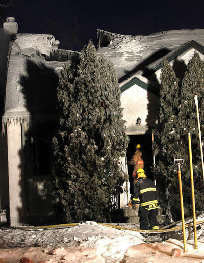 Fire damaged home on Fleet Avenue this morning.