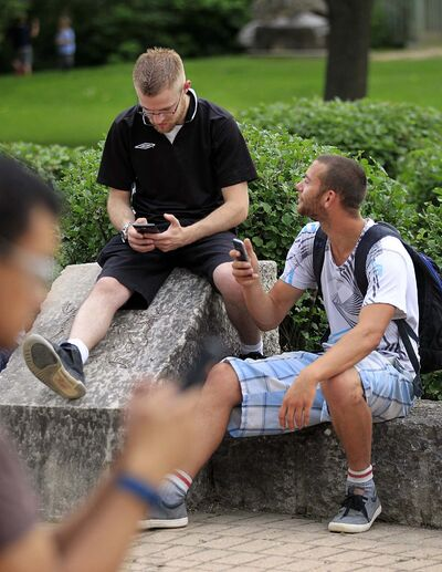 PHIL HOSSACK / WINNIPEG FREE PRESS</p><p>27-year-old Justin Enns (left) and Jesse Claeys, 24 followed their phone to a Pokemon meet-up at the Oneda Circle.</p>