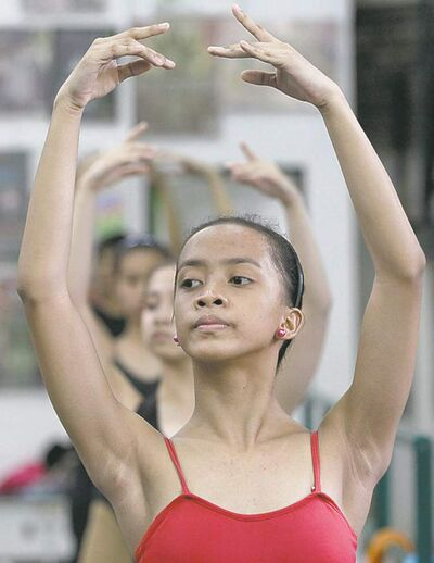 In this photo taken Nov. 25, 2012, Filipino slum dweller Jessa Balote rehearses during a class at Ballet Manila in the Philippine capital. Balote, who used to tag along with her family as they collect garbage at a nearby dumpsite, is a scholar at Ballet Manila's dance program. As an apprentice, she makes around 7,000 pesos ($170) a month, sometimes double that, from stipend and performance fees. (AP Photo/Aaron Favila)
