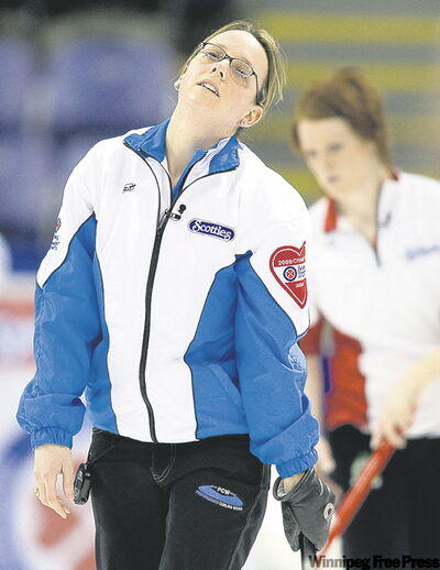 Quebec skip Marie­ France Larouche reacts to missing an important shot.