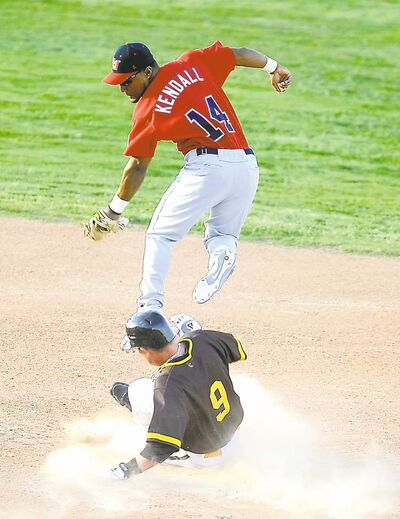 Michael Norris / Amarillo Globe-News Winnipeg�s Price Kendall is forced to come off the bag as Amarillo�s Matt Tucker slides into second base safely during the Goldeyes� season opener at Amarillo National Bank Sox Stadium Friday. When the dust settled, the Fish were 1-0.