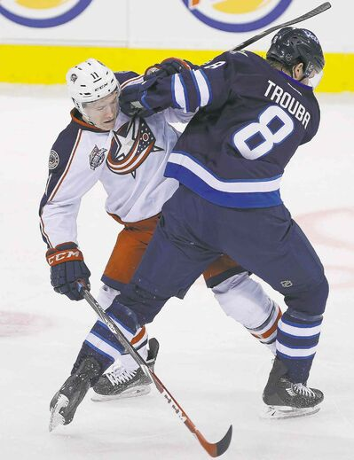 John Woods / the canadian press Jets blue-liner Jacob Trouba and Blue Jackets forward Matt Calvert collide during first-period action at the MTS Centre Wednesday night.