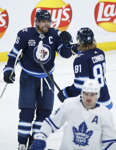 Winnipeg Jets' Blake Wheeler and Kyle Connor celebrate Connor's goal against the Toronto Maple Leafs during the second period. THE CANADIAN PRESS/John Woods
