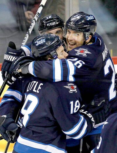 Jets' Andrew Ladd (16), Bryan Little (18), Blake Wheeler (26) and teammates need to keep on executing to keep on smiling.