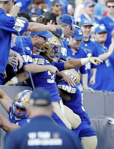 Winnipeg Blue Bombers' Andrew Harris celebrates his touchdown during first half CFL football action against the Toronto Argonauts.