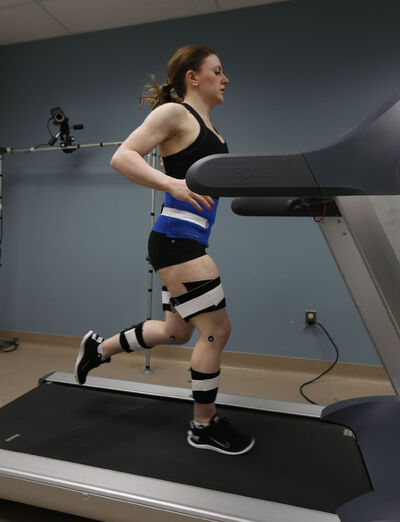 Sarah Flett, a 3D Gait Analysis technician/kinesiologist  at the PanAm Clinic, has her lower-body movements recorded by the machine while running on a treadmill.