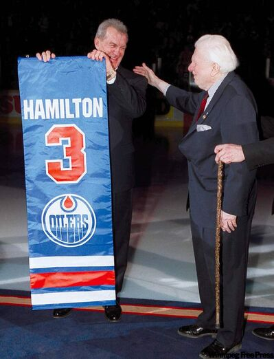 Dennis Murphy (above), a WHA co-founder, had tons of colourful ideas on how to promote the new league. At right, �Wild� Bill Hunter and Al Hamilton stand at centre ice as Hamilton�s number gets retired in Edmonton in April 2001. Hamilton was the Edmonton Oilers� first captain.