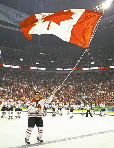 Canada's Sidney Crosby skates with tha flag after scoring the overtime winning goal in men's ice hockey gold medal final at the 2010 Winter Olympic Games in Vancouver, Sunday, Feb. 28, 2010.