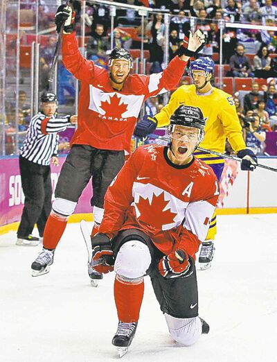 Canada forward Jonathan Toews reacts after scoring a goal against Sweden during the first period of the men�s gold medal ice hockey game at the 2014 Winter Olympics, Sunday, Feb. 23, 2014, in Sochi, Russia. (AP Photo/Matt Slocum)