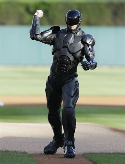 The movie character Robocop throws out a ceremonial first pitch before a baseball game between the Detroit Tigers and the Toronto Blue Jays in Detroit, Tuesday, June 3, 2014. (AP Photo/Carlos Osorio)