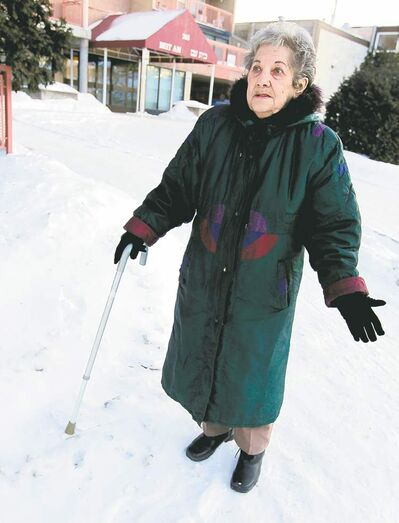 BORIS MINKEVICH / WINNIPEG FREE PRESS West Kildonan resident Elsie Karl must walk on the roadway because the sidewalks haven't been cleared of snow.
