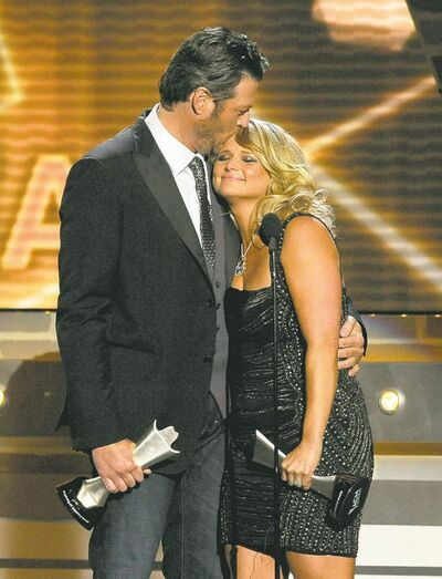 Miranda Lambert and Blake Shelton accept the award for song of the year for Over You at the Academy of Country Music Awards in Las Vegas on Sunday.