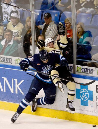 St. John's IceCaps' Ben Chiarot hits Wilkes-Barre/Scranton Penguins' Bobby Farnham during an AHL hockey Eastern Conference finals playoff game in May. He played one game for the Jets last year.