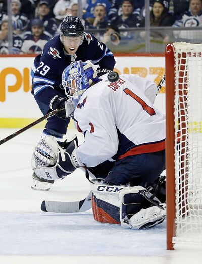 Winnipeg Jets' Patrik Laine watches his shot go just wide off Washington Capitals goaltender Pheonix Copley during the second period Wednesday.