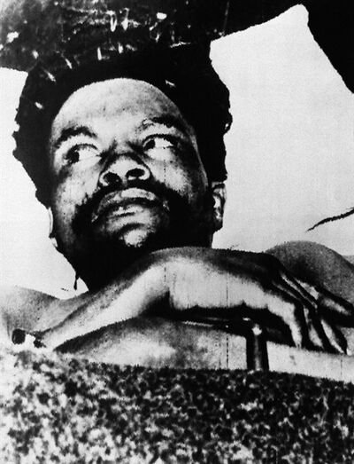 In this Oct. 21, 1956 file photo, Dedan Kimathi, one of the most revered Mau Mau fighters who the British arrested and hanged, lies wounded on a stretcher after being shot in the thigh by a policeman, at a hospital in Nyeri, north of the capital Nairobi, in Kenya.