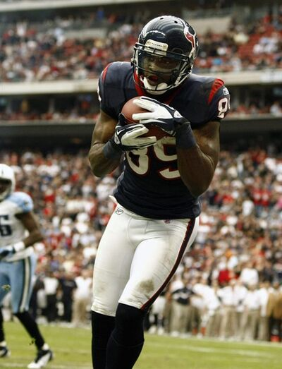 Houston Texans wide receiver Bryant Johnson (89) scores a touchdown against Tennessee Titans during the second half of an NFL football game on Sunday, Jan. 1, 2012, in Houston, Texas. (AP Photo/Waco Tribune Herald/Jose Yau)