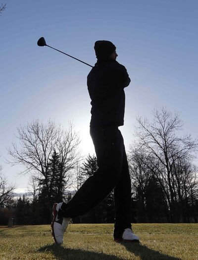 Tuxedo Golf Course opened for the season at 8 a.m. Friday. John Ali  takes practice swings for his first time this year in cool but sunny conditions.