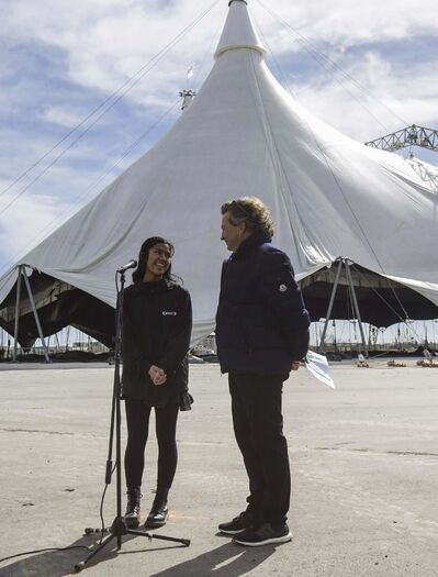 <p>Singer Maria Aragon and Cavalia's Founder and Artistic Director, Normand Latourelle, at the Cavalia Odysseo site Tuesday morning. Maria Aragon will be performing during the shows in May.</p>