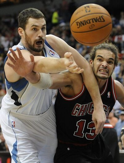 Minnesota Timberwolves' Kevin Love, left, and Chicago Bulls' Joakim Noah battle for the ball during the first half of an NBA basketball game, Tuesday, Jan. 10, 2012, in Minneapolis. (AP Photo/Jim Mone)