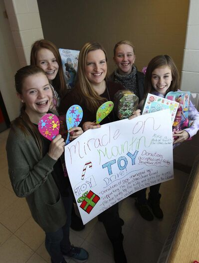 left, with barbie), Kaylee McMannes (blue</p><p>centre), and some of her Grade 7 Math and Science class students have been busy gathering new toys for our Miracle on Mountain for Christmas Cheer Board.</p><p>Names of students: Abby MacInnes , Veronica Sokolov and Alaina Simpson (right, in purple</p><p>RUTH BONNEVILLE / WINNIPEG FREE PRESS</p><p>Henry G. Izatt Middle School Teacher Kathy Stardom .</p></p></p><p>The whole class is busy gathering new toys for our Miracle on Mountain tree!</p></p><p>This photo is for Kevin&rsquo;s column.</p><p>Kevin Rollason | Reporter</p><p>Dec 0/7, 2017</p>
