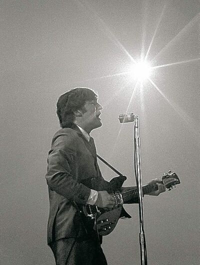 photos by Mike Mitchell / The Associated Press handout Photos of John Lennon (above) and the Beatles, taken in February 1964 by Mike Mitchell during the band�s first U.S. concert, are the centrepiece of a monthlong exhibit at the David Anthony Fine Art gallery in Taos, N.M.