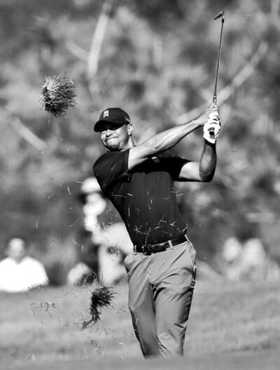Lenny Ignelzi / the associated pressTiger Woods wrecks some turf on his approach shot to the second hole of the South Course at Torrey Pines at the Farmers Insurance Open Saturday.